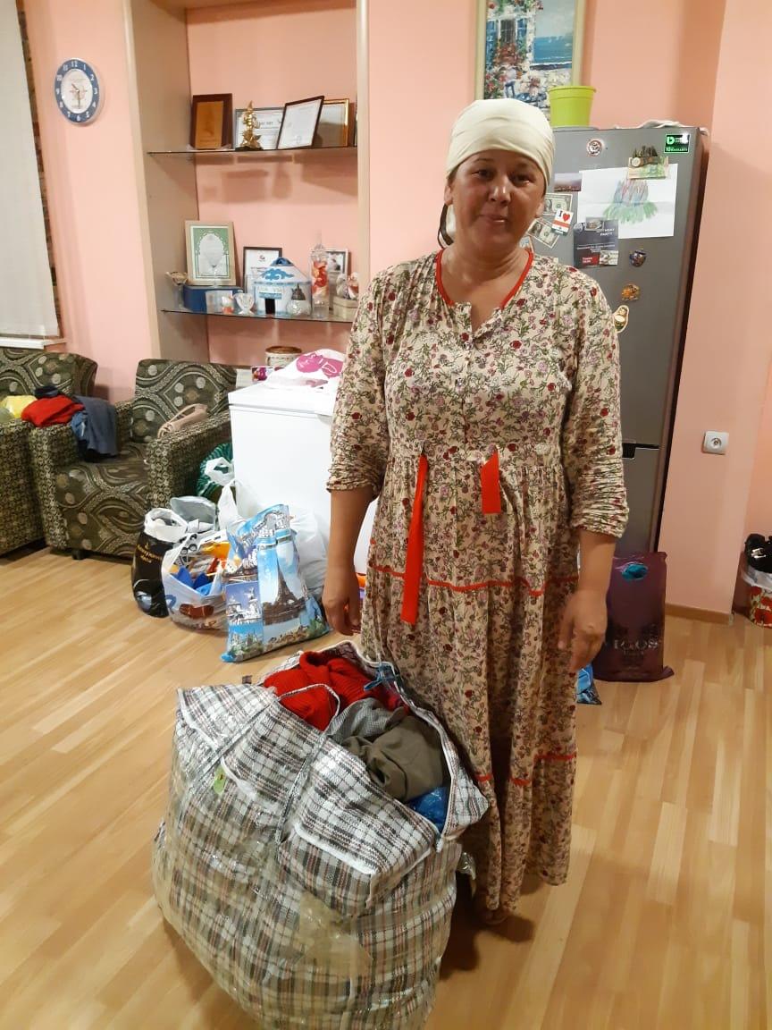 Малоимущим семьям в Актау раздали почти тонну одежды, фото-5