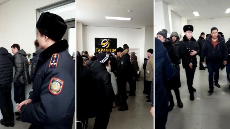 "Казахстанцы штурмуют офисы ""Гарант 24"", фото-1"